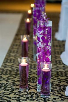 food coloring in glasses with floating candles... How cheap and easy!