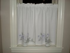 Great idea for those small RV windows - vintage pillowcases!