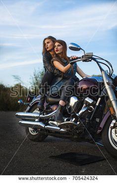 Sexy girls. Motorcycle couple.