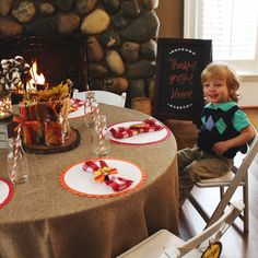 Fall 2016 Thanksgiving Styled Shoot featuring: Kids White Folding Chair, Mason Jar w/Handle, Quilted Jelly Jar, Milk Bottle, Brown Chalkboard Easel, Cross Bar Lantern, Glass & Antique Lantern, Bushel Basket, Square Grey Crates, White Pitcher, Red Checkered Linen, & Burlap Table Linen.