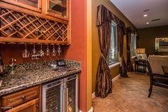 Traditional Bar with Built-in bookshelf & limestone tile floors in Phoenix, AZ   Zillow Digs