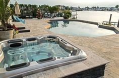 When building a new pool, these clients wanted a hot tub that would be as elegant as their new pool and patio. However, they wanted the spa to operate separatel… Hot Tub Surround, Sunken Hot Tub, Solar Pool Heater, Hot Tub Backyard, Backyard Gazebo, Backyard Pool Designs, Backyard Projects, Patio Design, Tub Enclosures