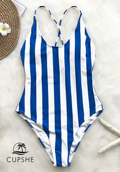 These stripe one-piece immediately add a touch of style to your poolside  look. 4b229f43d