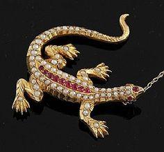 An antique Australian lizard brooch, the 15ct gold lizard set