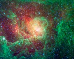 Swirling dust clouds and bright newborn stars dominate the view in this image of the Lagoon nebula from NASA's Spitzer Space Telescope. The ...