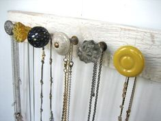 jewelry holder: get a strip of wood and some mismatched knobs that tie in colors from the room