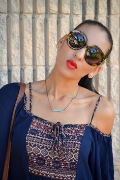 Casual outfit: flowy top, dainty turquoise necklace, oversized tortoise sunglasses