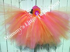 Pink Lemonade Tutu & matching flower clip by Mommy's Little TuTu Shop - This adorable bright tutu is a great way to dress up in the spring and summer for special occassions or a fun photo shot. This tutu can be made in any size and you can also order matching wings and wand for an adorable costume.