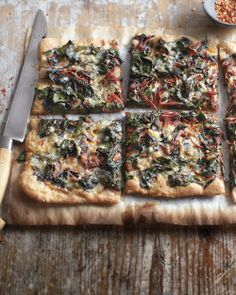 Swiss Chard, Garlic, and Gruyere Pizza: Pizza from scratch need not be solely a weekend pursuit. Start the dough in the morning, and let it slowly rise in the fridge over the course of the day. Our no-sauce version brings out the earthiness of chard. Pizza Recipes, Vegetarian Recipes, Healthy Recipes, Vegetarian Pizza, Healthy Pizza, Fall Dinner Recipes, Fall Recipes, Whole Wheat Pizza, Savarin