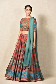 Ritu kumar presents this classic Lehenga with a trendy blouse for the young bride of today. In bright festive colors of red and turquoise and a modern, boat neck touch, this hand embroidered, gotta Lehenga is a must have. Lehenga Dupatta, Saree, Best Lehenga Designs, Ritu Kumar, Bridal Sari, Types Of Sleeves, Half Sleeves, Red Blouses, Sari Blouse Designs