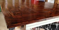 Red Mahogany tabletop (distressed) with antique jade apron.... just need to add the farmhouse chunky legs.
