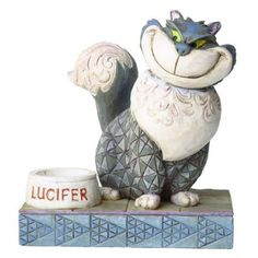 "Jim Shore Disneys Cinderella Cat ""Lucifer"" - manipulative Lucifer from Disneys animated Classic Cinderella is brought to you by Disney Traditions in the artful stylings from artist Jim Shore. Measures 5"" tall."
