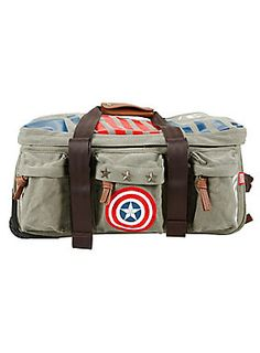 Vintage military style rolling duffel bag from Marvel with an allover <i>Captain America</i> inspired design. Features include interior cross straps; slip mesh pockets, duffel carry handle, pull handle and the 3 inline skate wheels