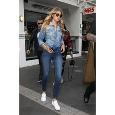 Gigi Hadid Proves The Double Denim Look Isn't Going Anywhere ❤ liked on Polyvore featuring tops, t-shirts, denim top, denim tee and denim t shirt