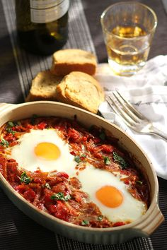 Sunnyside up eggs baked in chunky, spicy tomato sauce are a great brunch and light, quick dinner option. Tahini, Dinner Dishes, Dinner Recipes, Greek Shrimp, Spicy Tomato Sauce, Baking With Honey, Greek Cooking, Breakfast Time, Breakfast Cooking