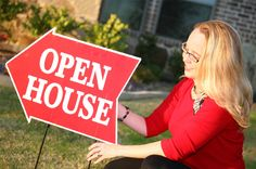 Homeselling Image URL: http://cdn.sheknows.com/articles/2010/12/woman-with-open-house-sign.jpg