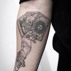 Hand Holding Tarot Cards @bangbangnyc #bangbangnyc @kristiwallsnyc #tattoo #tattoos #art #drawing #black #blackink #tattooartist #ink #inked #artist #tattooart #artistic #tarot #tarotcards #hand #sun #futureteller #cards #nyc