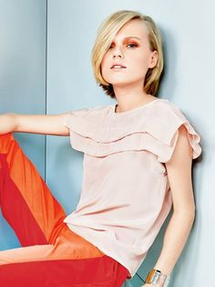 Women's top sewing pattern available for download. Available in various sizes and is produced by burda style magazine.  A square shaped blouse with double pleats at the front and back is fresh and modern. Pair this clean lined top with bright pants for an pretty spring look look, or tuck it into a pencil skirt.  This pattern is from the Day Glo collection.