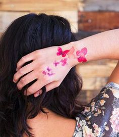 Watercolor butterfly tattoo on the hand. LOVE.