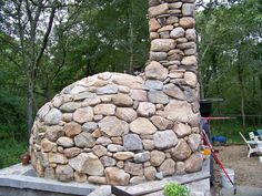 Stone veneer on a wood fired oven - Maine Wood Heat Co.