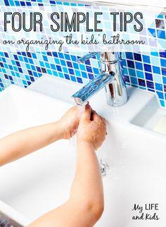 Four simple tips on organizing the kids' bathroom! I love the repurposed planter idea!