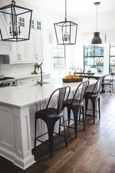 Farmhouse White Kitchen with black accents- love the cabinets and island