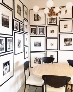 This gallery wall—or rather gallery corner—wraps around two walls and features treasured family photos in similar black frames with white mats. What a beautiful way to display these memories.