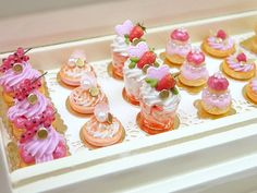 Miniature Food - An individual French Biscuit de Reims pink pastry swan, filled with pink cream. Presented on gold bakery board. A must for