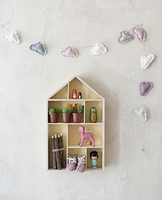 House shaped shelf and cloud garland