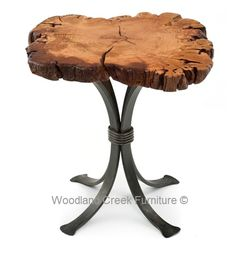 This live edge slab side table features a thick hand forged metal base paired with a beautiful organic shaped wood cross cut.  We have many species of wood.  The photos shows a cherry slab, but soon we will have beautiful slabs of burl wood as an option. This live edge slab side table is also