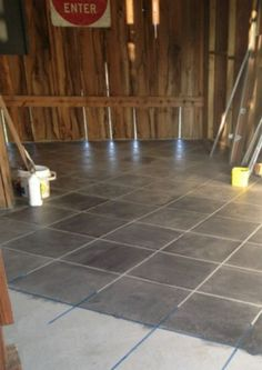 DIY: How to Stain a Concrete Floor to Look Like Tile - using concrete stain and painter's tape. This is the easiest way to dress up concrete - via Farm Fresh Vintage Finds