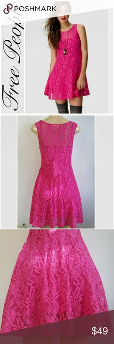 """Free People Women's Trapeze Dress Free People Miles of Lace Sheer Mini Dress. Features: Sheer floral lace in a solid hot pink color, sleeveless, pullover style, skater silhouette, mini above knee length, stretchy. Slip in included.? Measures approximately 17"""" across chest, 16"""" across the waist, and is approximately 33"""" long. Excellent condtion. Free People Dresses Mini"""