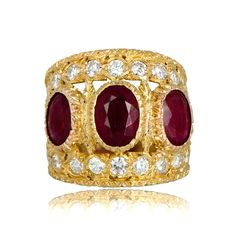 A stunning Vintage Buccellati Ruby Ring, set in 18k gold and adorned with diamonds. Fine handcrafted engravings add to the characteristic delicacy of this ring.This ring was made in Italy, circa 1960. Signed M. Buccellati.