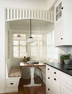 we love the side drawers, but our small kitchen won't let those work. we will do storage benches you can open from the top!