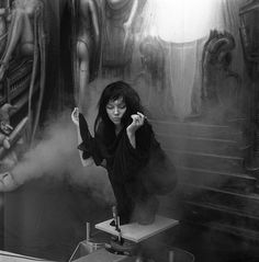 Debbie Harry, perhaps in supplication, among H.R. Giger's artwork. Photo by Chris Stein, 1981.