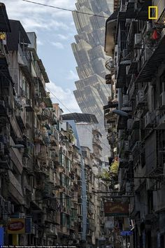 A street in Macau with the Grand Lisboa Casino looming in the background. Photograph by Paul Tsui, National Geographic travel photographer of the year. - A street in Macau with the Grand Lisboa Casino looming in the background. Photograph by Paul Tsui, - Macao, National Geographic Travel, Scary Places, Ghost In The Shell, Travel Photographer, Rwby, Futuristic, Scenery, Street View