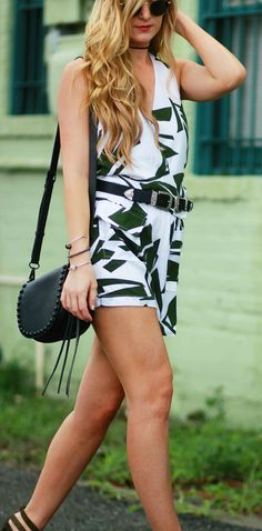 Fall transition outfit styled with a palm print romper, olive lace up sandals, and black studded crossbody bag
