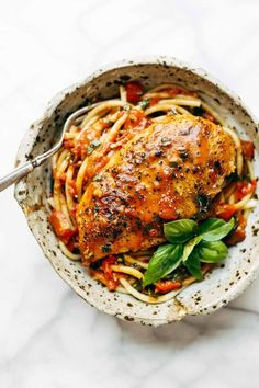 Garlic Basil Chicken - you won't believe that this easy real food recipe only requires 7 ingredients like basil, garlic, olive oil, tomatoes, and butter.
