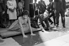 JACK LEMMON and SHIRLEY MACLAINE leaving their prints in the cement at Grauman's Chinese Theatre on June 29, 1963. They costarred together in The Apartment (1960) and Irma la Douce (1963), both written and directed by Billy Wilder.