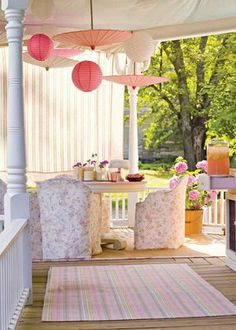 Pretty pink porch the plastic chairs are covered in a floral fabric.