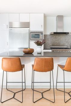 Spotted: Our Saddle Leather Bar Stools tying together this condo kitchen! Seen on Brownstoner