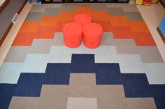 The floor in Brady's playroom — 56 carpet tiles from Flor.com. Flor playroom carpet tiles in a chevron pattern. Blue, light blue, grey, orange Flor tiles.