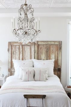ceiling tiles. chandelier. wood headboard. white linens. so much natural light!