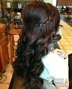 I love this! Curled, but has a braid and is half up, with some poof! | best stuff