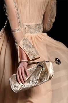 light peach organza dress with beautiful sequin work on open cuffs, sleeves, and waistband