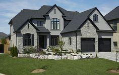 again, grey brick instead of stone, blended grey stucco, black doors and windows (trim)