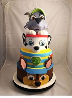 This PAW Patrol layered birthday cake featuring Chase, Marshall, and Rocky is…