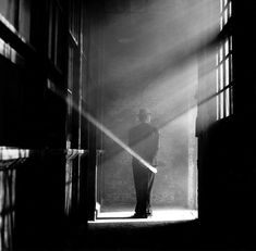 Photo by Rodney Smith (I love the capture of the brightest beam through his hands..magical)