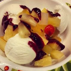 Delicious yogurt icecream with fruitscocktail and blueberryjam