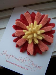 Sweet flower pin using felted wool.